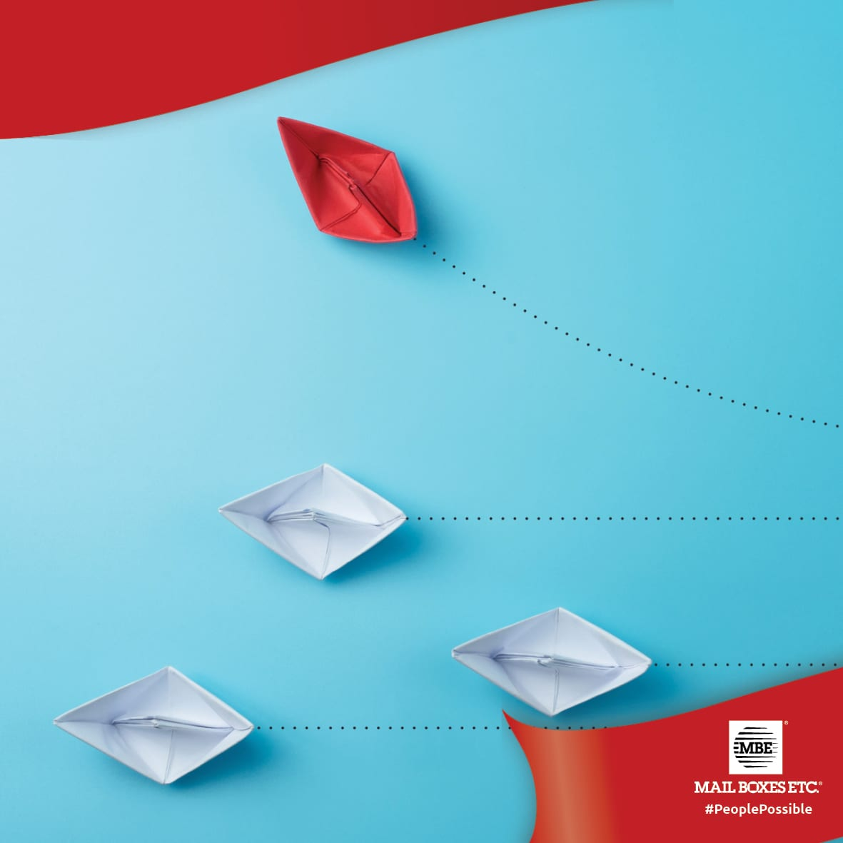 Red & Colour paper boats on blue background